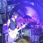 Guitarist, keyboardist, songwriter and producer Tom Scholz with the band, Boston playing at the Buffalo Chip campground.
