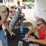 """Please no Pictures"" Paul Teutul Sr. from Orange County Choppers autographing a picture for me. Shortly after, I signed one for him. (yeah right.. ;-)"